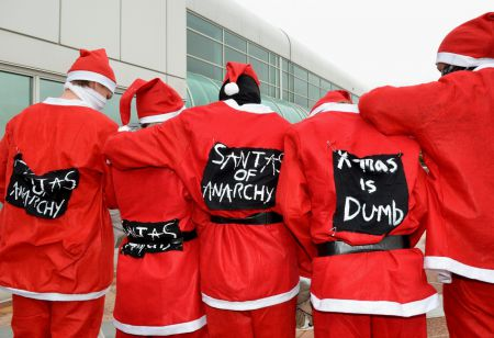 The Santas of Anarchy delivered a holiday message to stop a massive coal port expansion in Vancouver. Photo by murray bush - flux photo