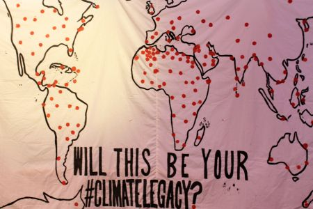 A display of a map of the world representing areas most impacted by climate change. Photo: Crystel Hajjar
