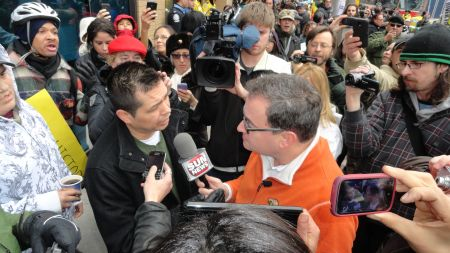 Protesters outside of the Sun News studio in Toronto on January 19, 2013, confront, and are interviewed by, SN host Ezra Levant, who has been a vociferous critic of Idle No More and Chief Theresa Spence. PHOTO: Peter Biesterfeld.