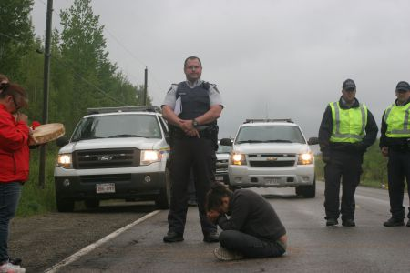 On June 9th, Suzanne Patles was arrested for mischief while praying in front of SWN's seismic testing equipment. It was the third arrest of the summer. Photo by Miles Howe