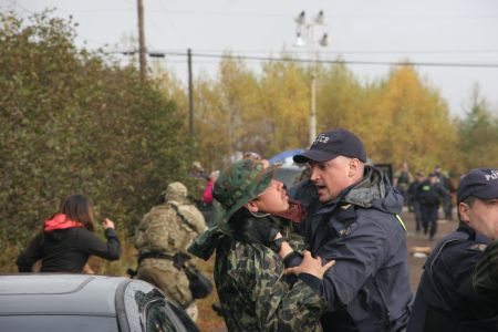 When cops attack. On October 17th, RCMP from Nova Scotia, PEI, New Brunswick and Quebec descended upon an anti-shale gas encampment with their guns drawn. [Photo: Miles Howe]