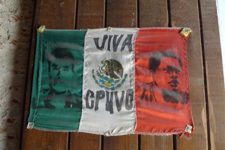 "A Mexican flag reads ""Long Live CPUVO"" and bears the portraits of Bernardo Méndez and Bernardo Vásquez, the two anti-mine activists who were killed in early 2012. Photo by Sara Méndez"